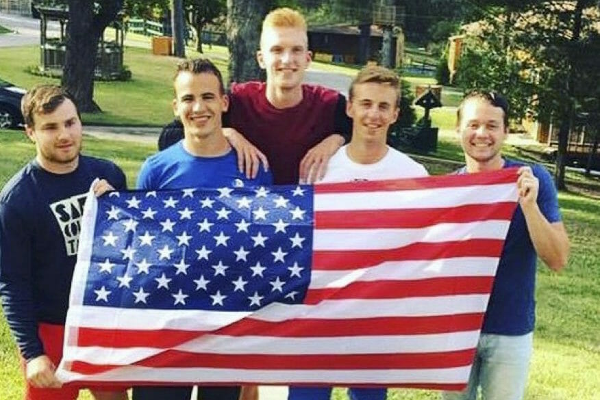 group of boys holding an american flag