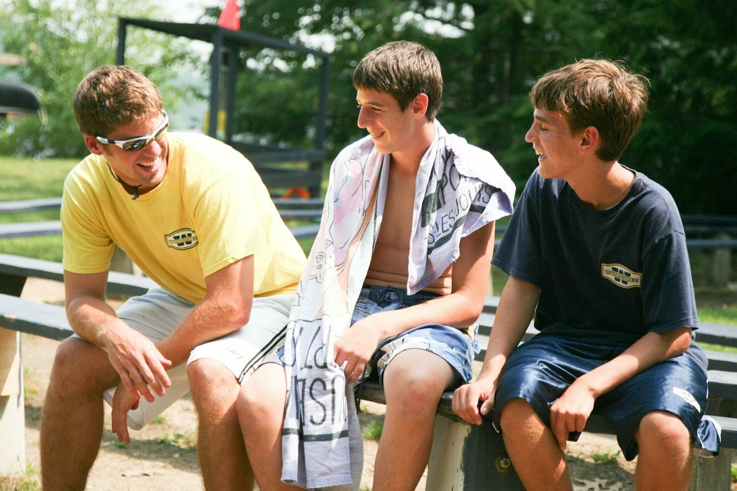 USA summer camp boys and counselor laughing