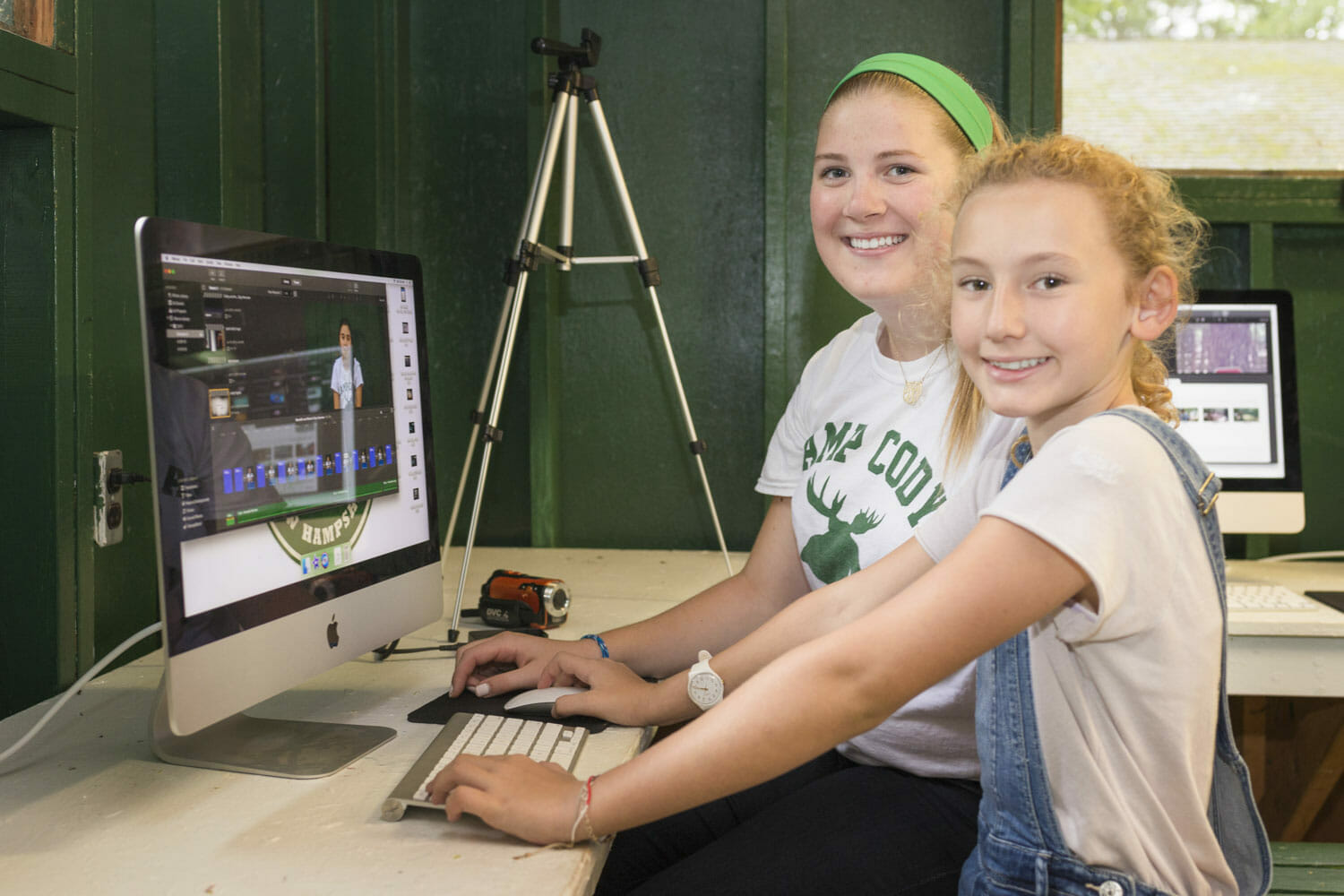Female counselor and camper at computer class