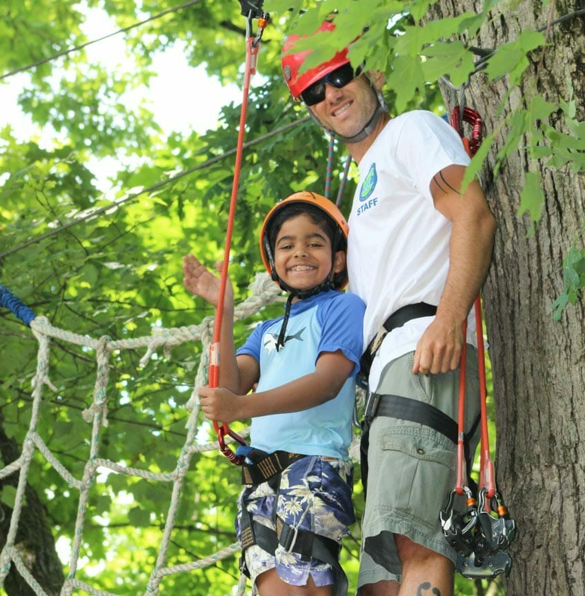 Camper and counselor on ropes course