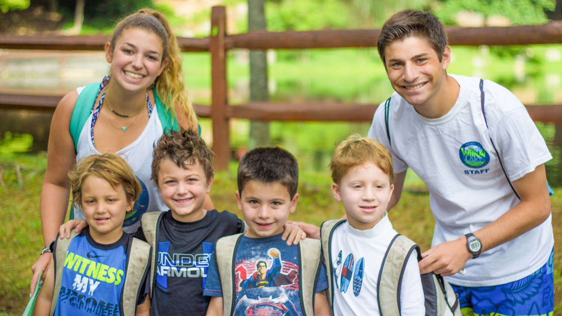 Male and female counselors with campers in America