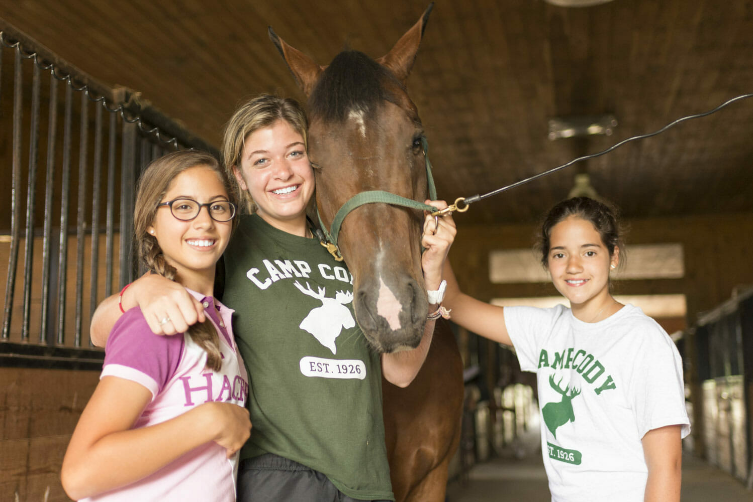 Girls with horse and counselor at USA camp