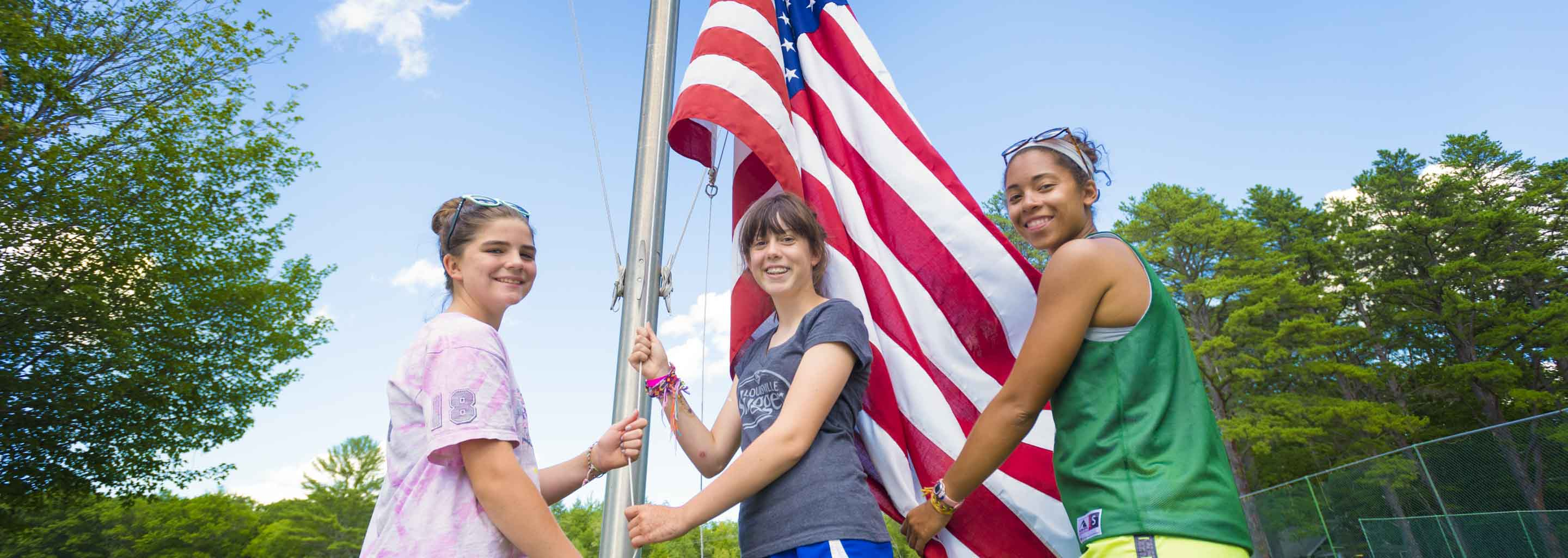 Counselors Raise an American Flag at Summer Camp