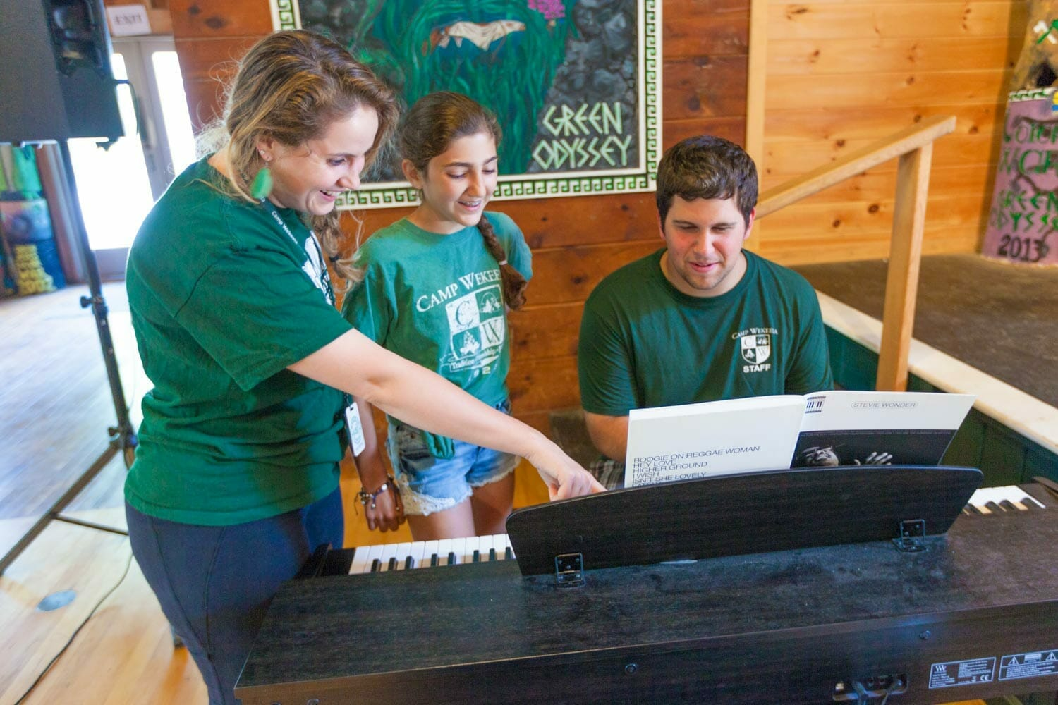 Counselors Teach Piano at Summer Camp