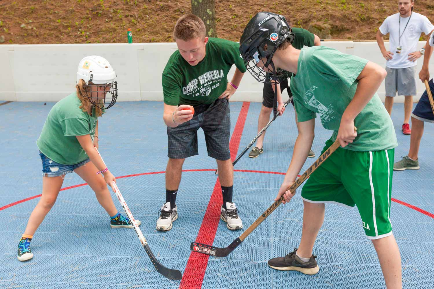 Street hockey game at summer camp