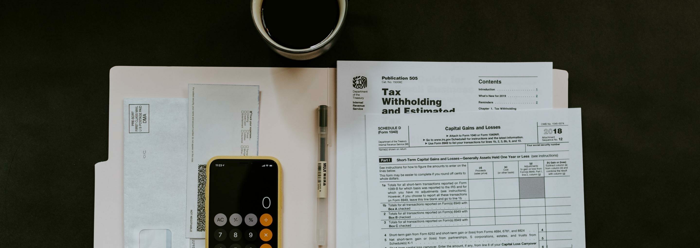 Tax return paperwork and folder